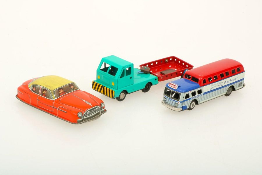 A (3) piece lot with tole toys. A.O. Greyhound bus. In good condition with origi…