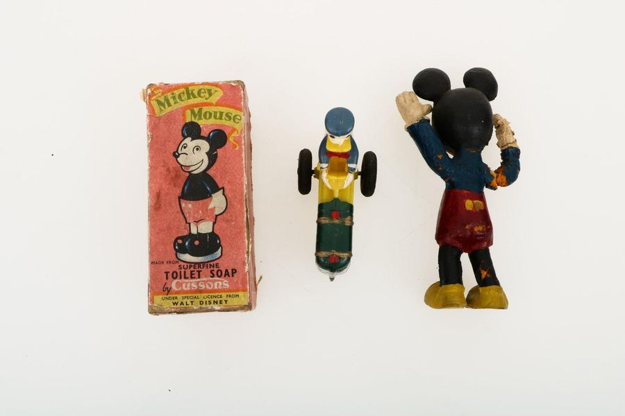 A (3) piece lot with Disney collectables. A.W. Mickey Mouse toilet soap , Donald…