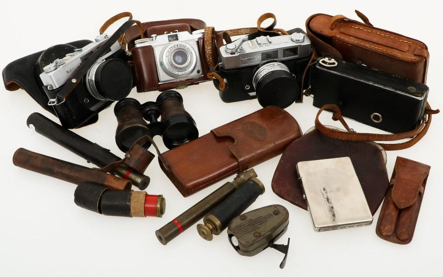A large lot with camera`s , binoculars etc. Consisting of various cameras, theat…