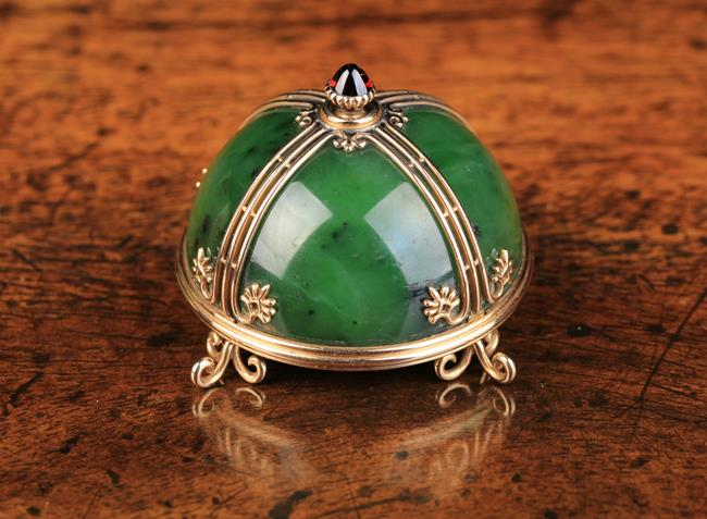 A Fabergé Gold Mounted Nephrite Electric Bell Push. The 14 carat rose gold mount…