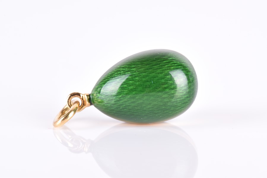 Faberge. An 18ct yellow gold and green enamel egg pendant   by Victor Mayer, the…