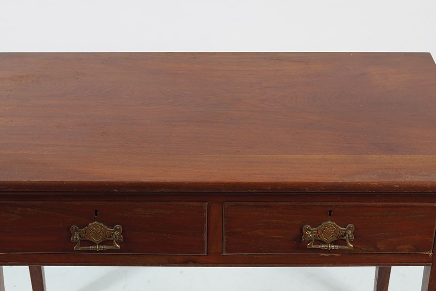 19TH CENTURY MAHOGANY SIDE TABLE the rectangular shaped top, above two frieze dr…