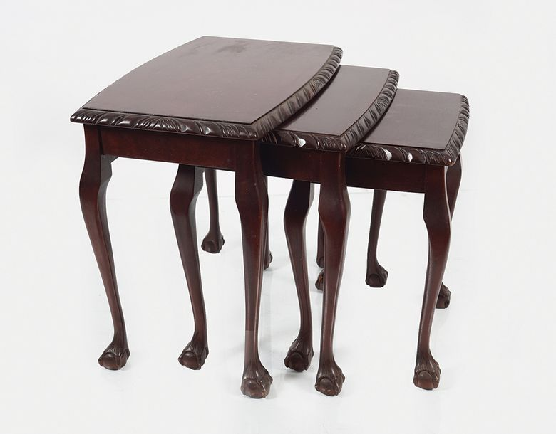DUBLIN MAHOGANY NEST OF THREE TABLES each with a rectangular gadrooned top, bowe…