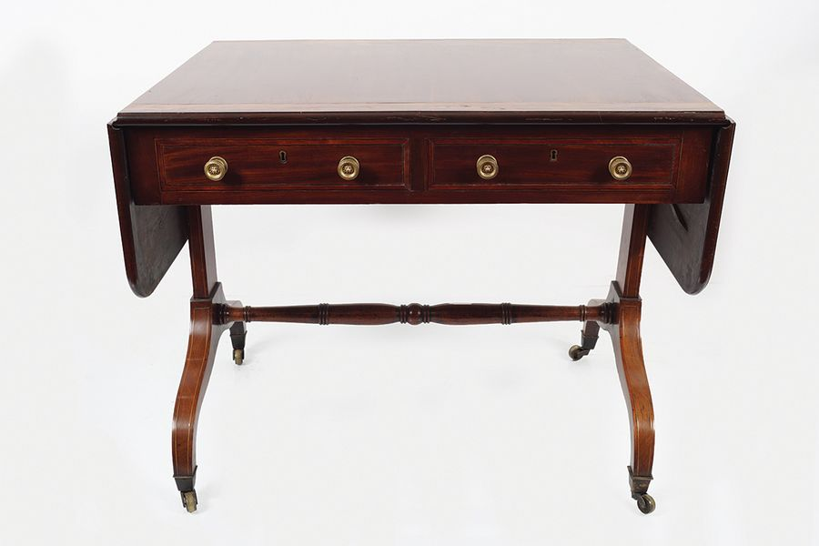 REGENCY PERIOD MAHOGANY AND SATINWOOD SOFA TABLE the rectangular crossbanded top…