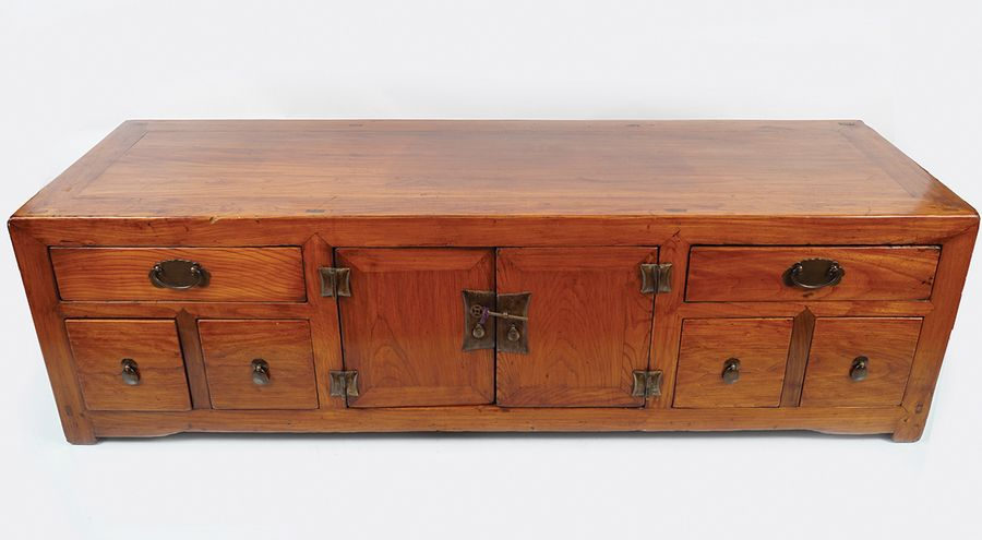 EARLY 20TH CENTURY CHINESE LOW HARDWOOD CABINET the elongated rectangular top, a…