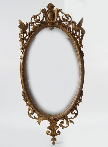 GEORGE III PERIOD GILTWOOD FRAMED PIER MIRROR the oval plate within a beaded and…