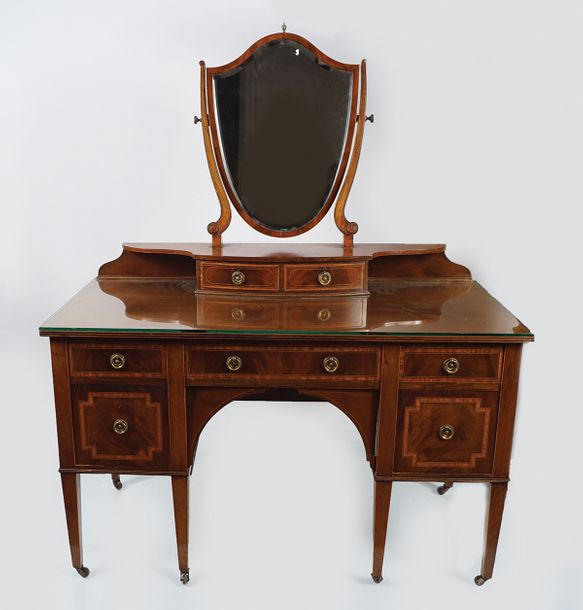 EDWARDIAN MAHOGANY AND SATINWOOD DRESSING TABLE the rectangular top above a seri…