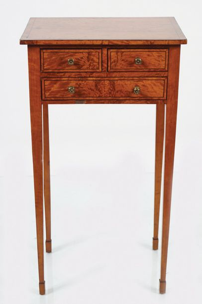 GEORGE III PERIOD SATINWOOD & EBONY INLAID TABLE Circa 1790, the rectangular top…