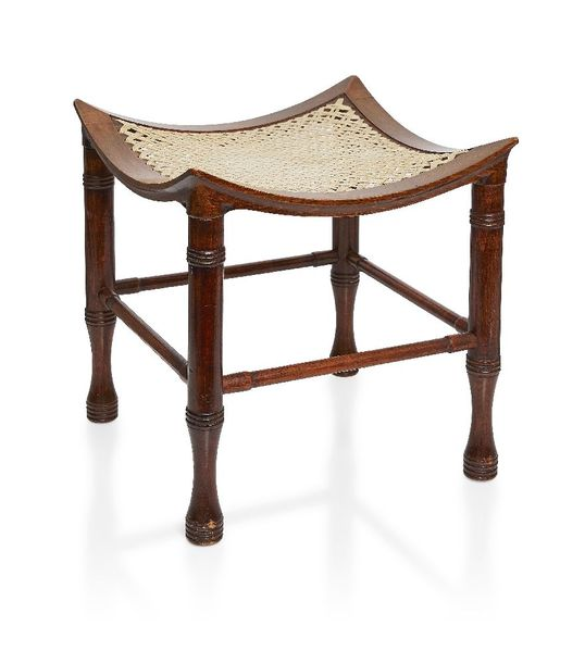 A stained beech Thebes stool probably retailed by Liberty and Co c.1900, unsigne…