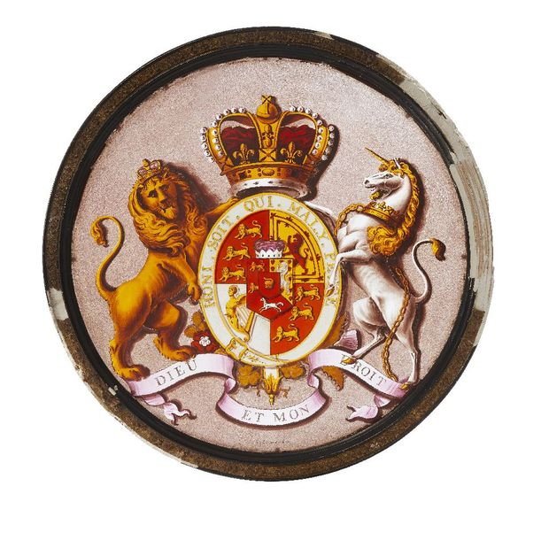 A painted circular glass panel bearing a coat of arms of the Order of the Garter…