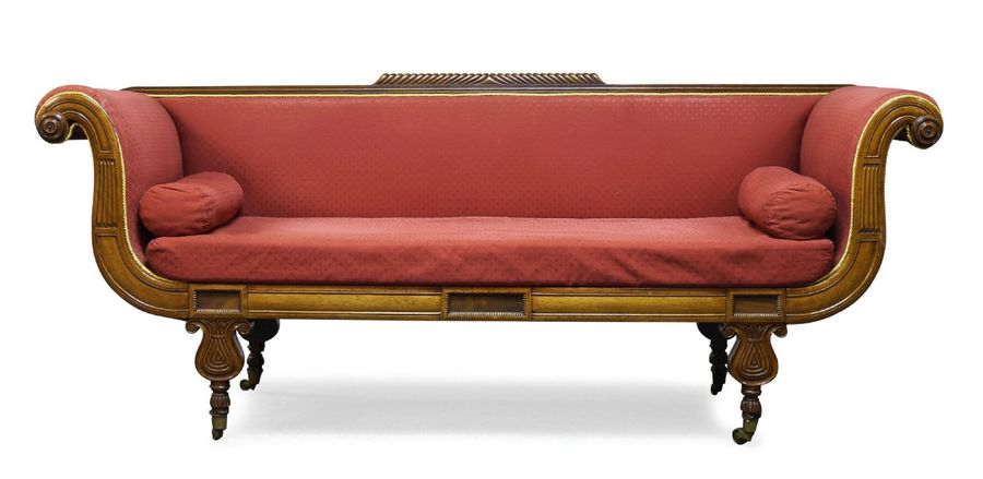 A Regency mahogany sofa, the top rail with raised gadrooning, having carved scro…