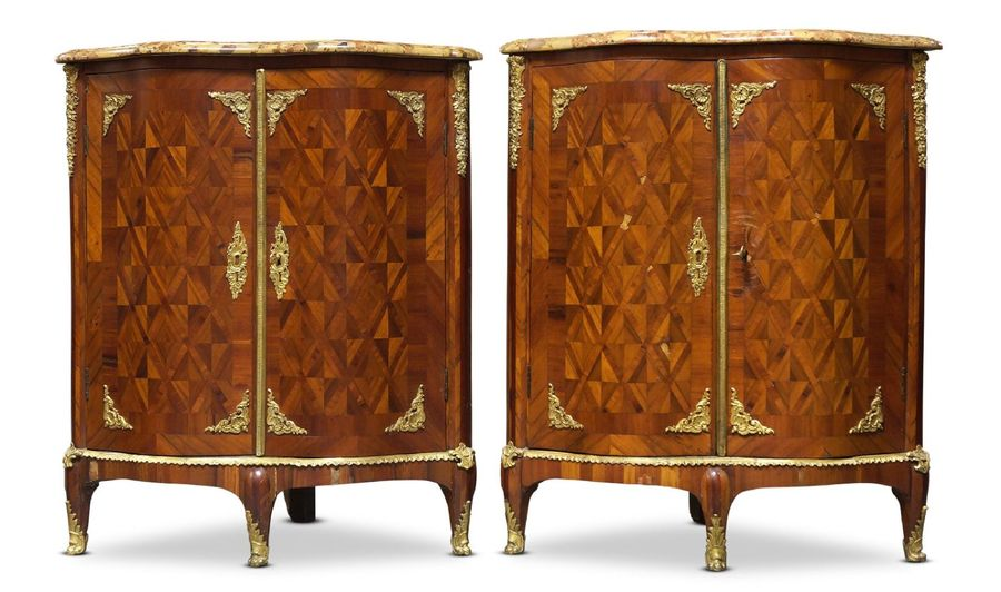 A pair of Louis XV serpentine kingwood, parquetry and ormolu mounted encoignures…