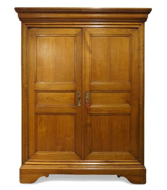 A French provincial fruitwood armoire, 19th Century, the moulded top above two p…