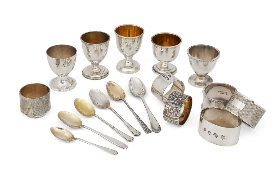 A quantity of silver eggcups and napkin rings, all in individual boxes, comprisi…
