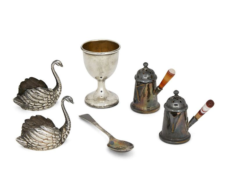 Two miniature German silver swans, both with flat bases and realistically chased…