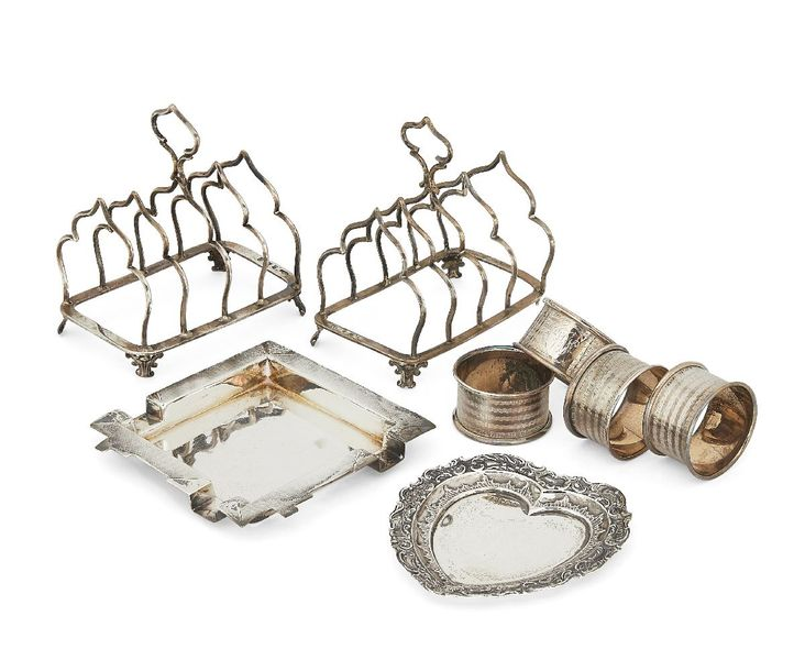 A pair of silver toast racks, Birmingham. C.1901 and 1902, both Marples & Co., t…