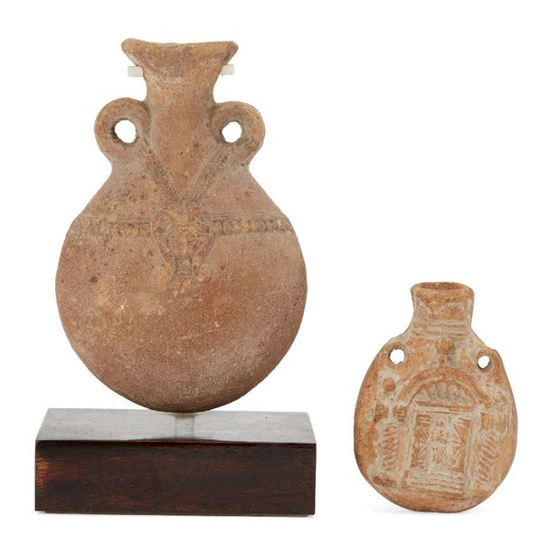 Two pottery flasks, including a vessel with two small handles, the swollen body …