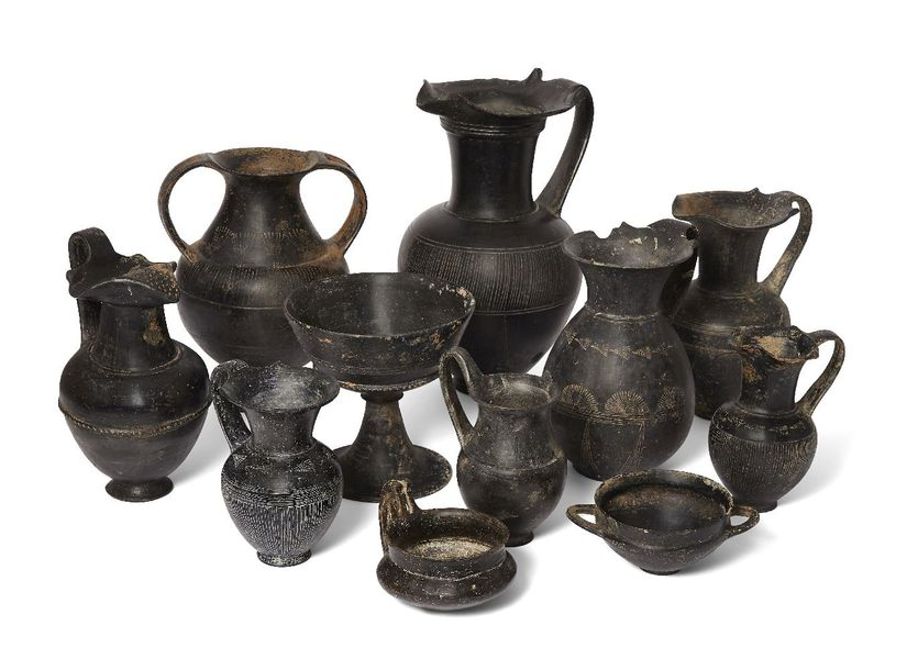 A group of eleven Etruscan bucchero ware vessels, circa 7th 6th Century B.C., co…