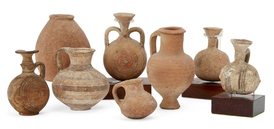 A group of pottery vessels including a Cypro Mycenaean vessel with squat globula…