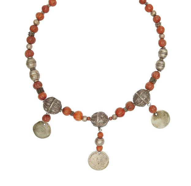 A silver and carnelian bead necklace, Yemen, late 18th 19th century, with silver…