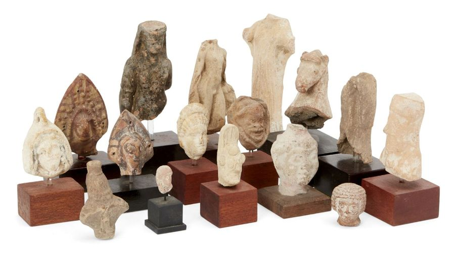A group of sixteen fragmentary mainly ancient terracottas, including an archaisi…