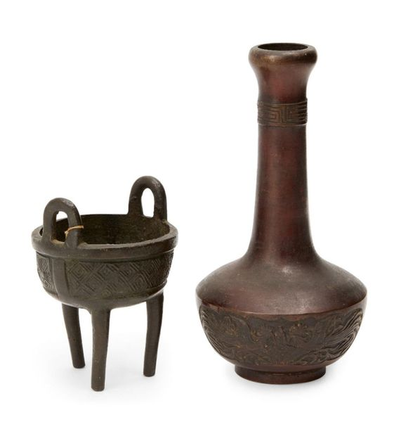 A Chinese bronze miniature tripod vessel, ding, 17th century, with high loop han…