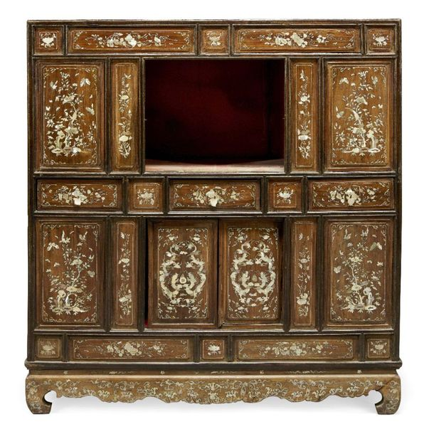 A Chinese mother of pearl inlaid cabinet, 19th century, with arrangement of draw…