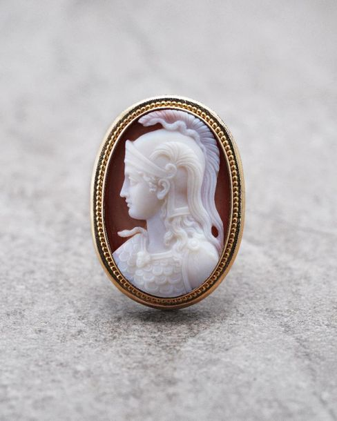 A nineteenth century gold framed hardstone cameo brooch, depicting a helmeted At…