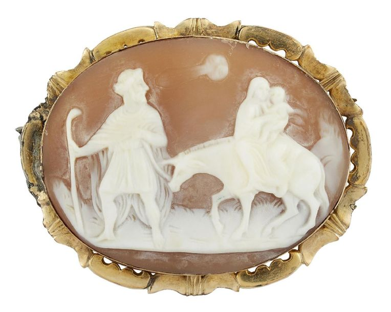 A late 19th century gold mounted shell cameo brooch, the oval cameo carved to de…