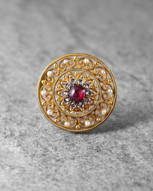 A 19th century Russian gold, diamond and spinel circular brooch, the central cab…