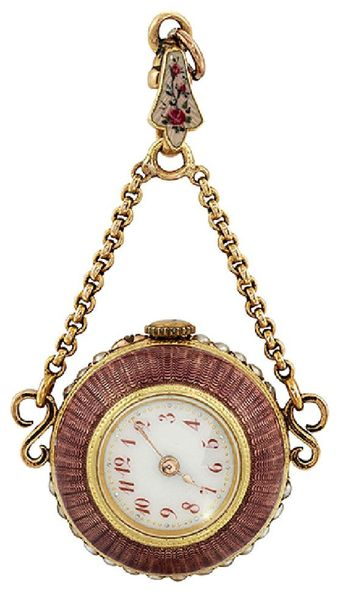 An early 20th century gold and enamel ball pendant watch, the white enamel dial …