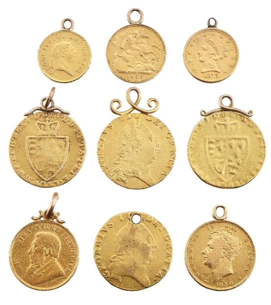 A group of nine pendant mounted gold coins, comprising: four George III spade gu…