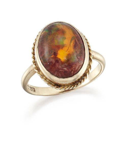 A Mexican fire opal single stone ring, the single cabochon opal in collet settin…