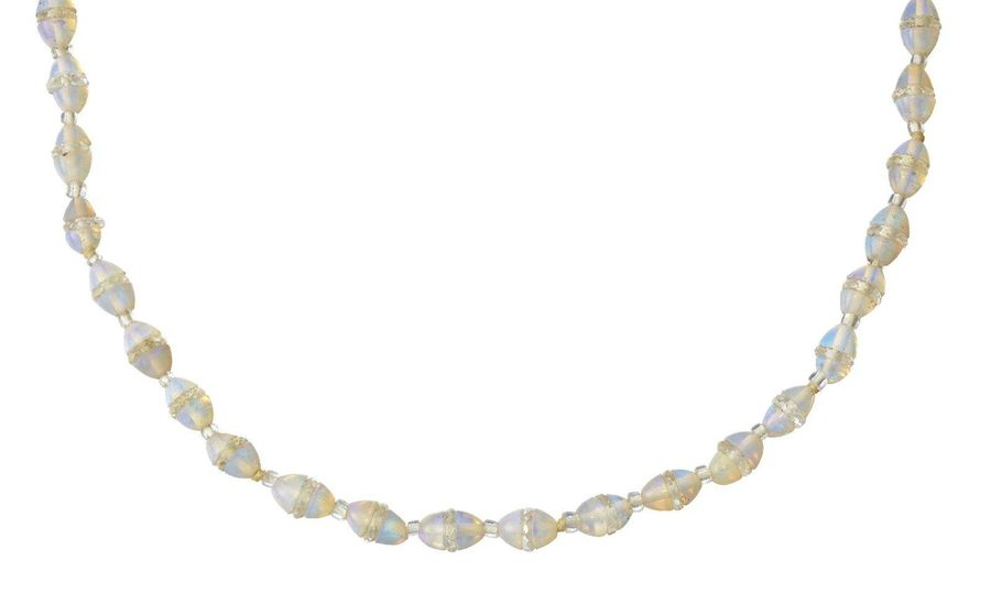 An opal necklace, composed of a single row of opal and faceted rock crystal thre…