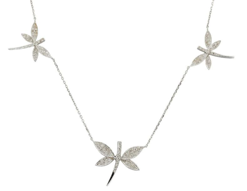 An 18ct white gold and diamond dragonfly necklace, the three pave set diamond dr…