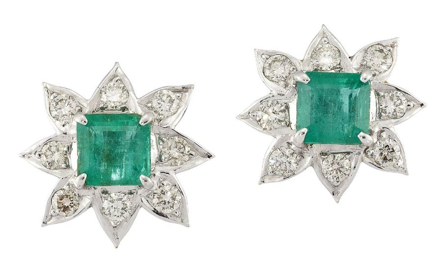 A pair of emerald and diamond cluster earrings, of flowerhead design, each cut c…