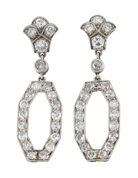 A pair of diamond drop earrings, the old circular cut diamond hexagonal loop dro…