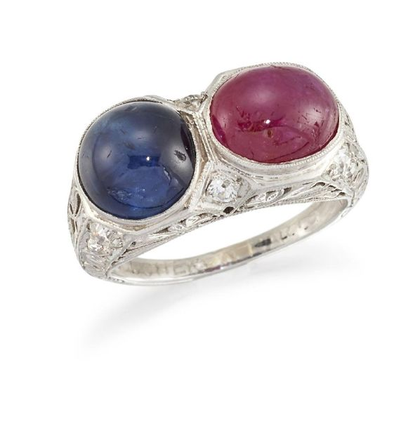 A ruby, sapphire and diamond ring, composed of an oval ruby cabochon and a circu…