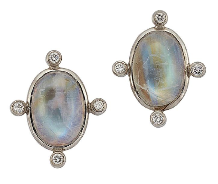 A pair of 18ct white gold, moonstone and diamond earrings, each closed set oval …