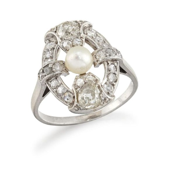 A platinum, diamond and pearl oval cluster ring, of openwork quatrefoil design, …