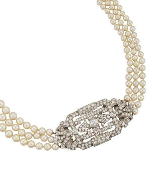 A cultured pearl and diamond necklace, the triple row of graduated pearls to an …