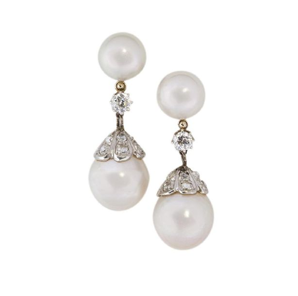 A pair of cultured pearl and diamond ear pendants, the cultured pearl drops with…