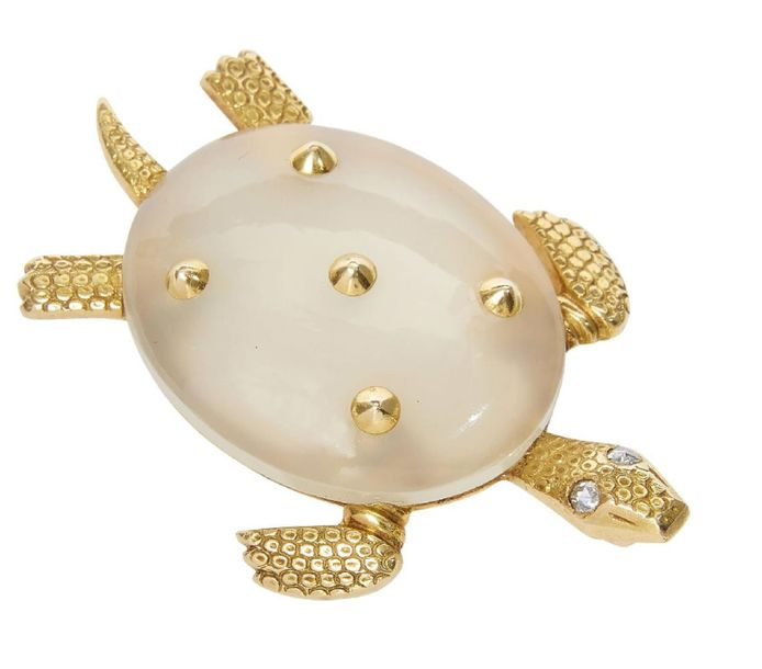 A diamond and white chalcedony turtle brooch, by Cartier, the chalcedony shell d…