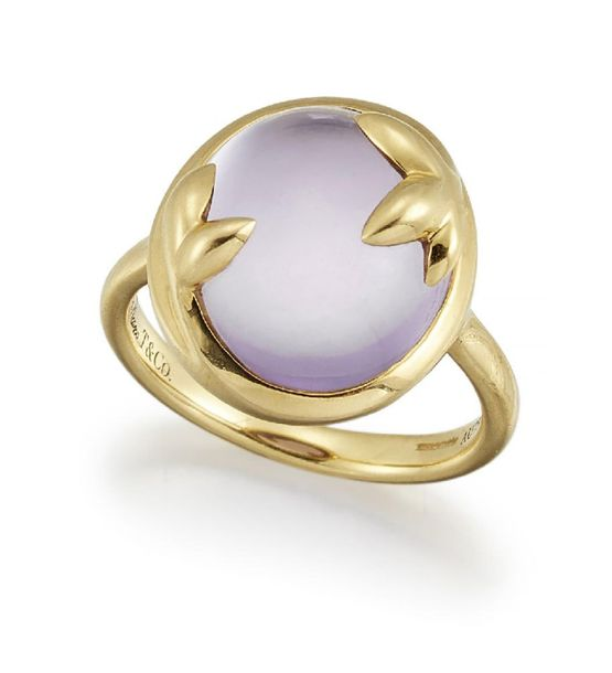 A Paloma Picasso amethyst 'Olive Leaf' ring, by Tiffany and Co., the oval amethy…