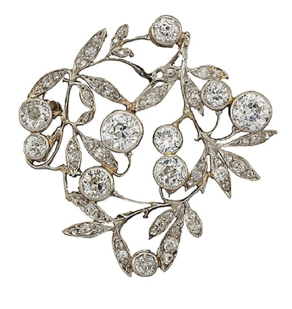 A Belle Epoque diamond brooch, designed as an openwork floral cluster spray set …