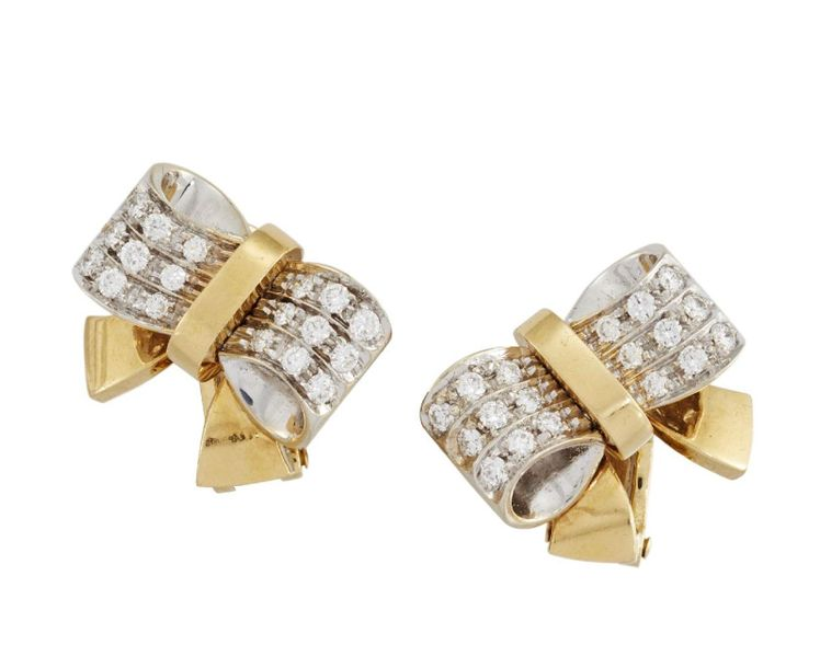 A pair of diamond clip earrings, by Pomellato, of stylised bow design, the shoul…