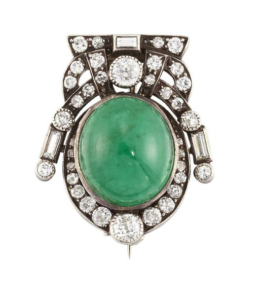 An emerald and diamond brooch, the oval cabochon emerald within an old brilliant…