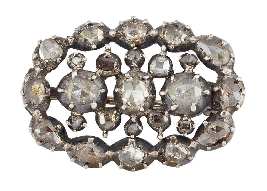 A late 18th century diamond brooch, of oval openwork design set with rose cut di…