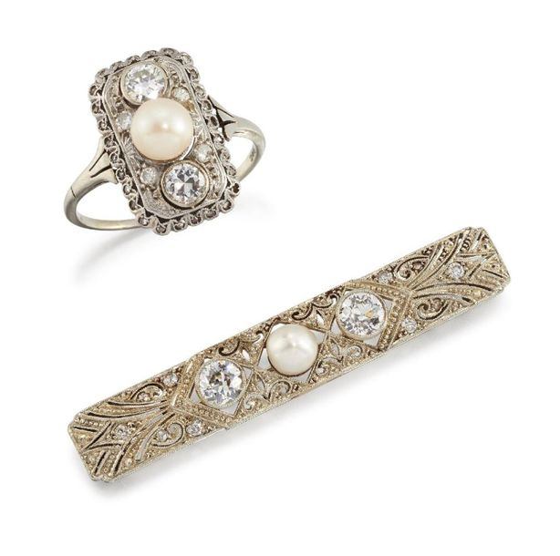 An early 20th century pearl and diamond brooch and an imitation pearl and diamon…