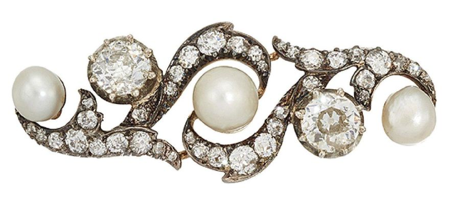 A late 19th century pearl and diamond brooch, of old cut diamond scroll design w…